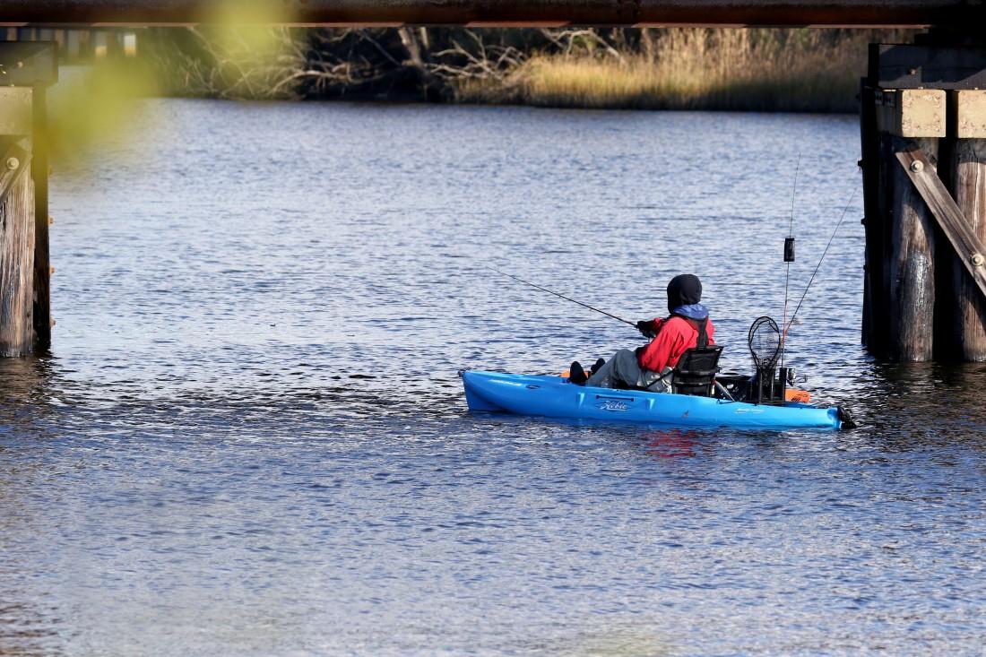 Pedal kayak fisherman in Scuffletown Creek