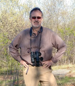 Dave Gibson, the author, in the field bird watching