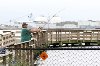 Man fishing by the Elizabeth River