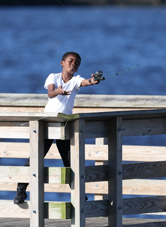 Boy fishing from a pier