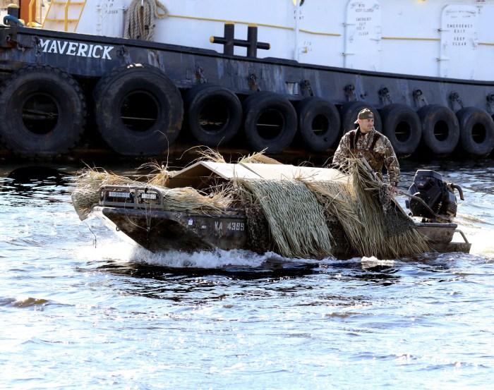 A hunter returns to a dock